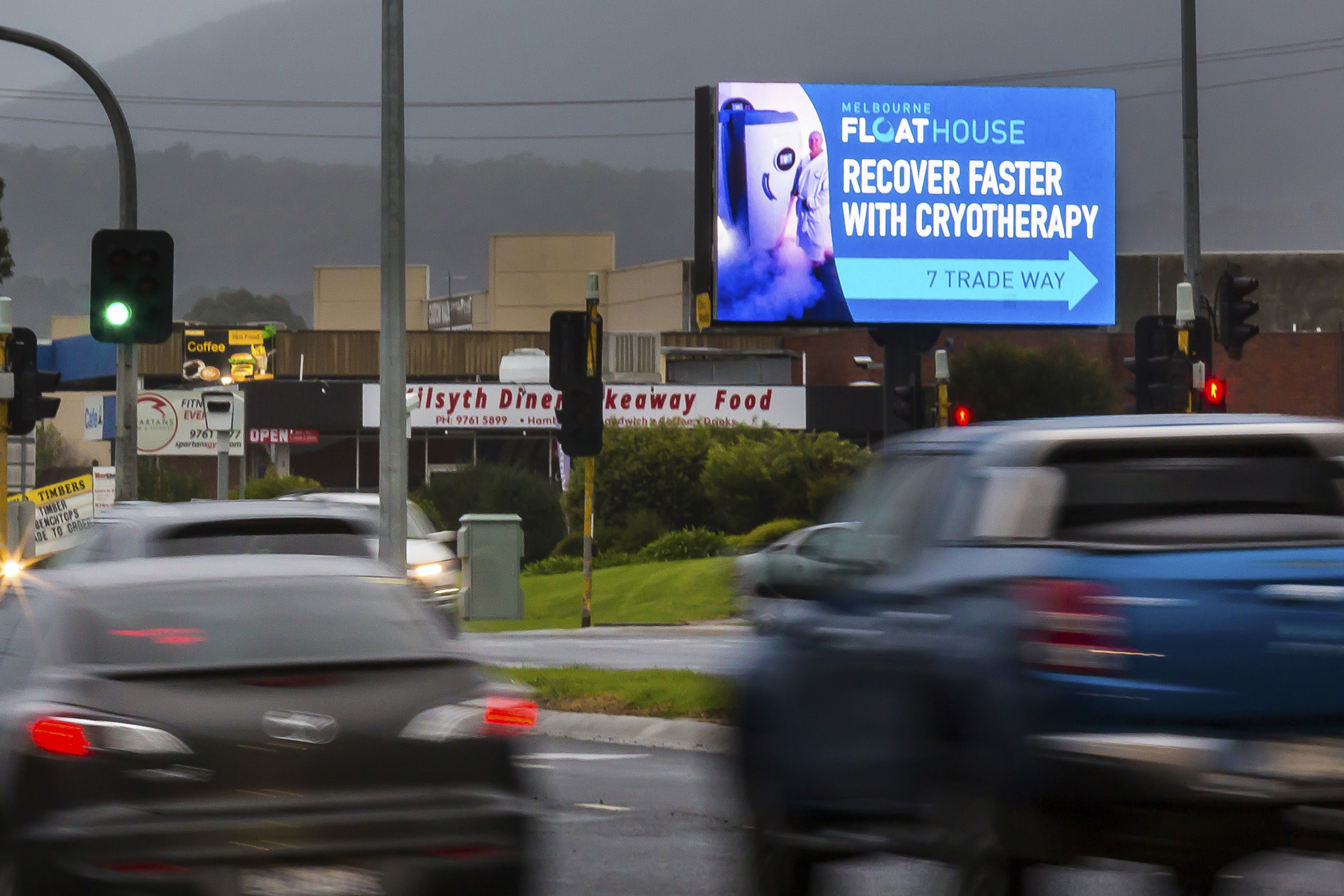 A digital billboard promoting a local business to passing traffic