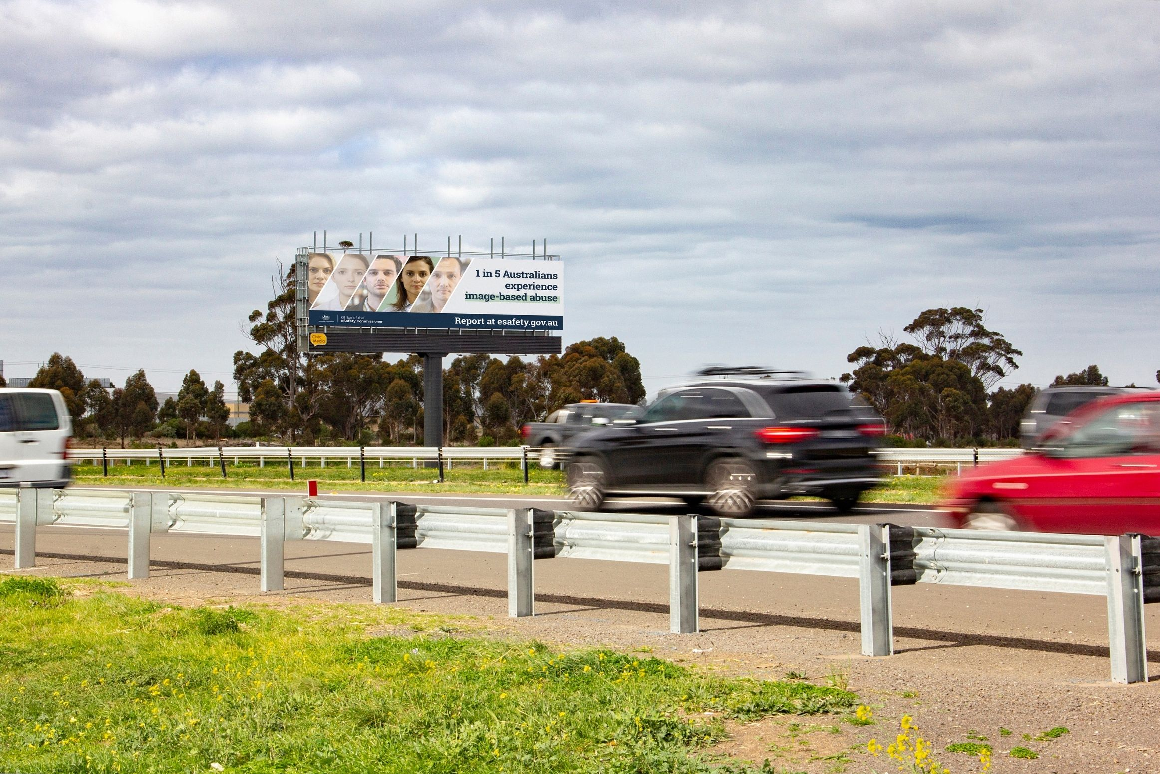 A digital billboard displaying some outdoor advertising to oncoming traffic
